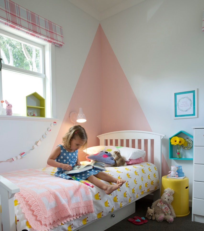 Even though this room has a large pink triangle triangle on the wall, it isn't overpowering because it is a lovely soft muted pink that isn't too candy floss.  It also works really well with other colours and we mix it up with red and yellow and turquoise so it isn't a totally pink room.