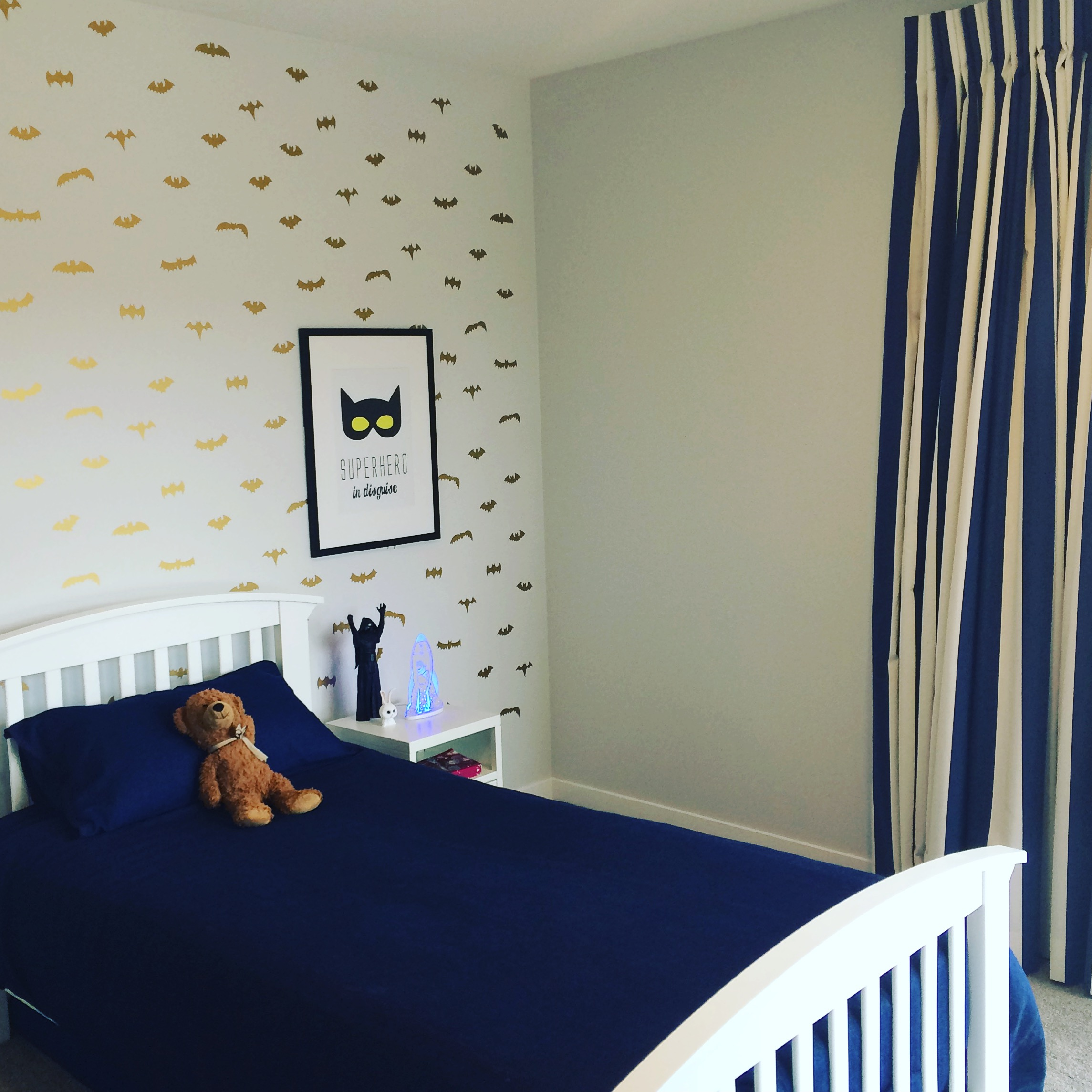 When a super hero room was requested this was my solution - gorgeous gold batman decals (which work perfectly with other gold or brass details we were doing in the home), and a super cool bat man print.  The denim duvet is going to get better and better with age just like your favourite pair of jeans along with the denim blue striped curtains.  All in a neutral room with pale grey walls and pale grey (bullet proof solution dyed nylon) carpet.