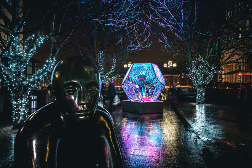 Dazzling Dodecahedron lite at night at Canary Wharf