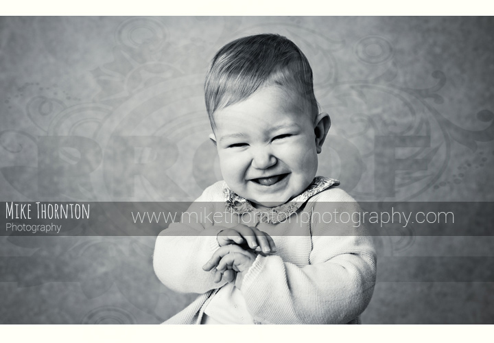 cute giggling baby photographer