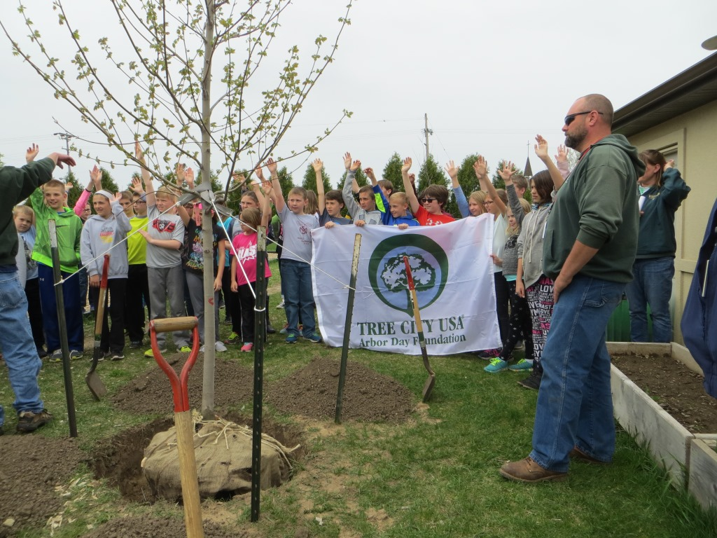 West Bend_tree planting3_hands up.JPG
