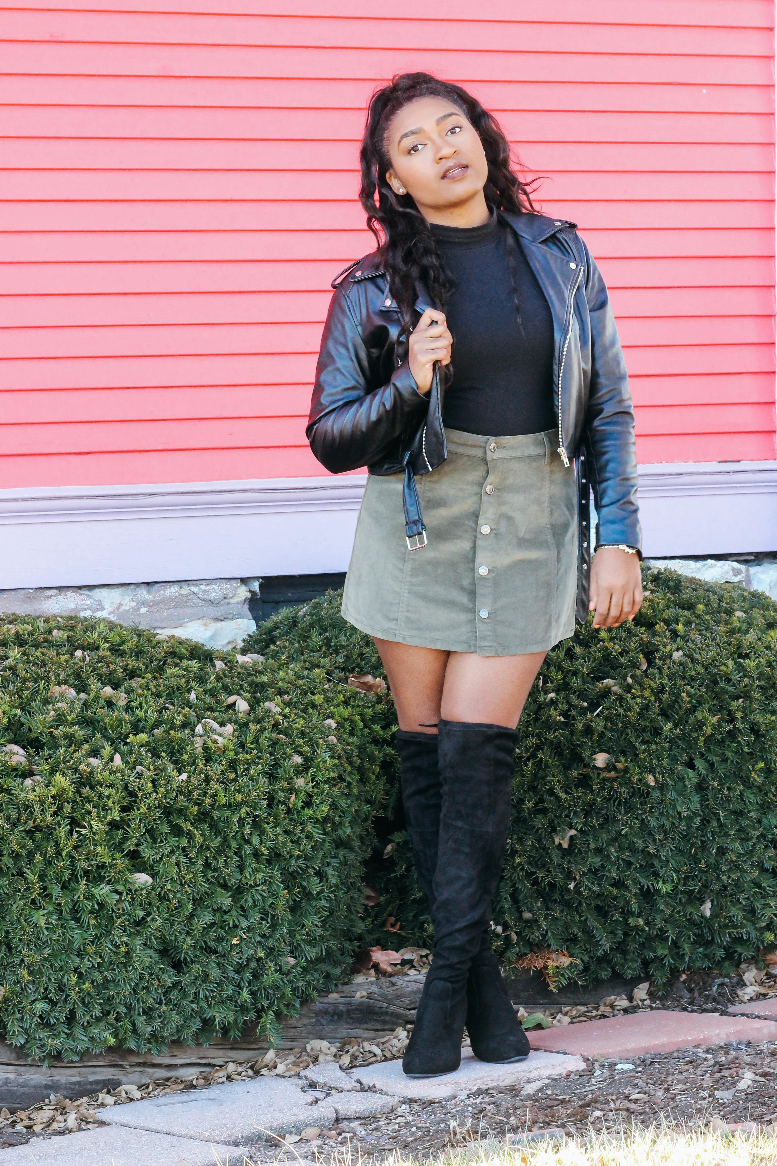 jasmine diane wearing a mini skirt with knee high boots #ootd in kansas city with black and green