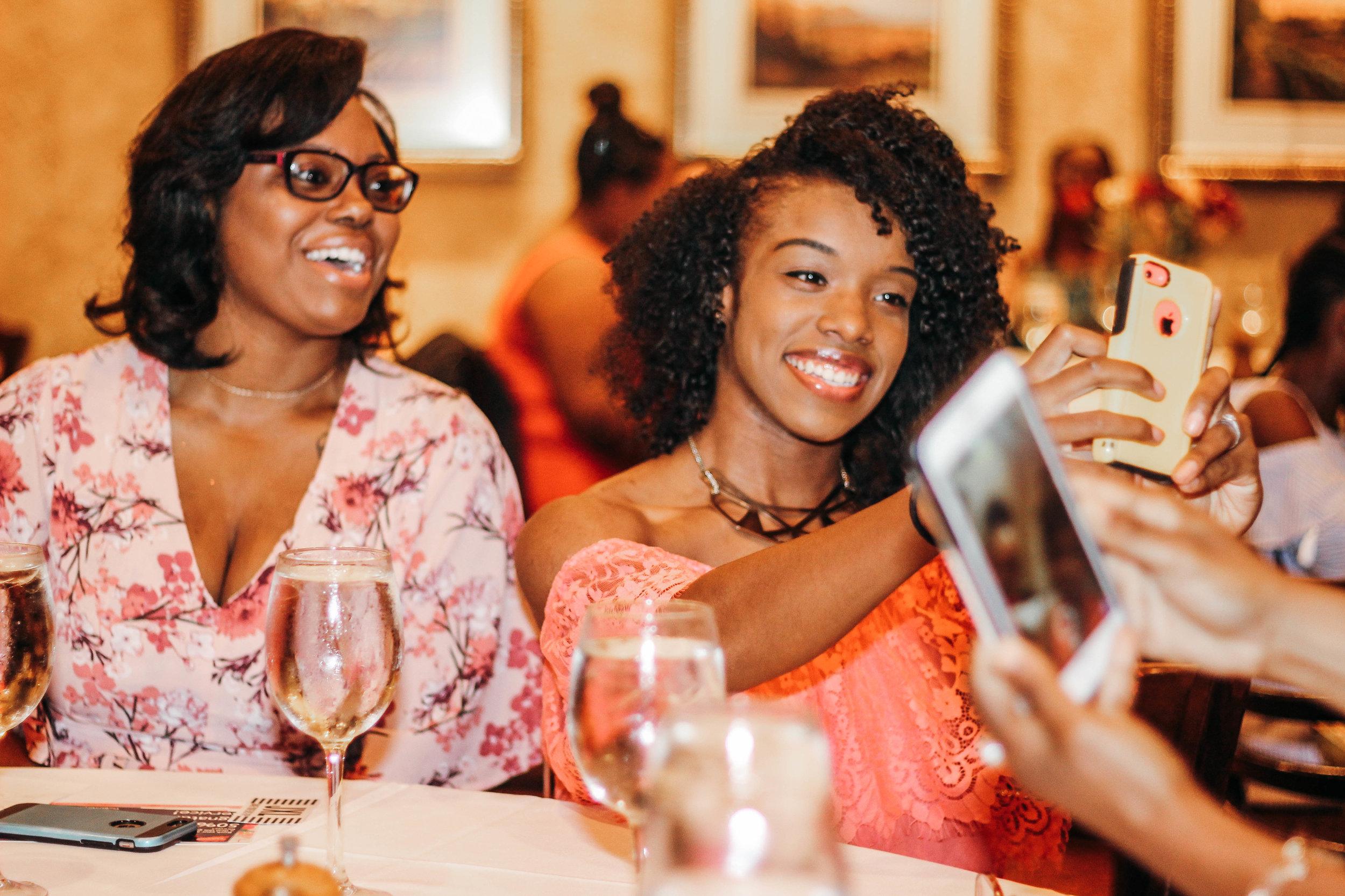 black women taking selfies at the jasmine diane summer brunch.jpg