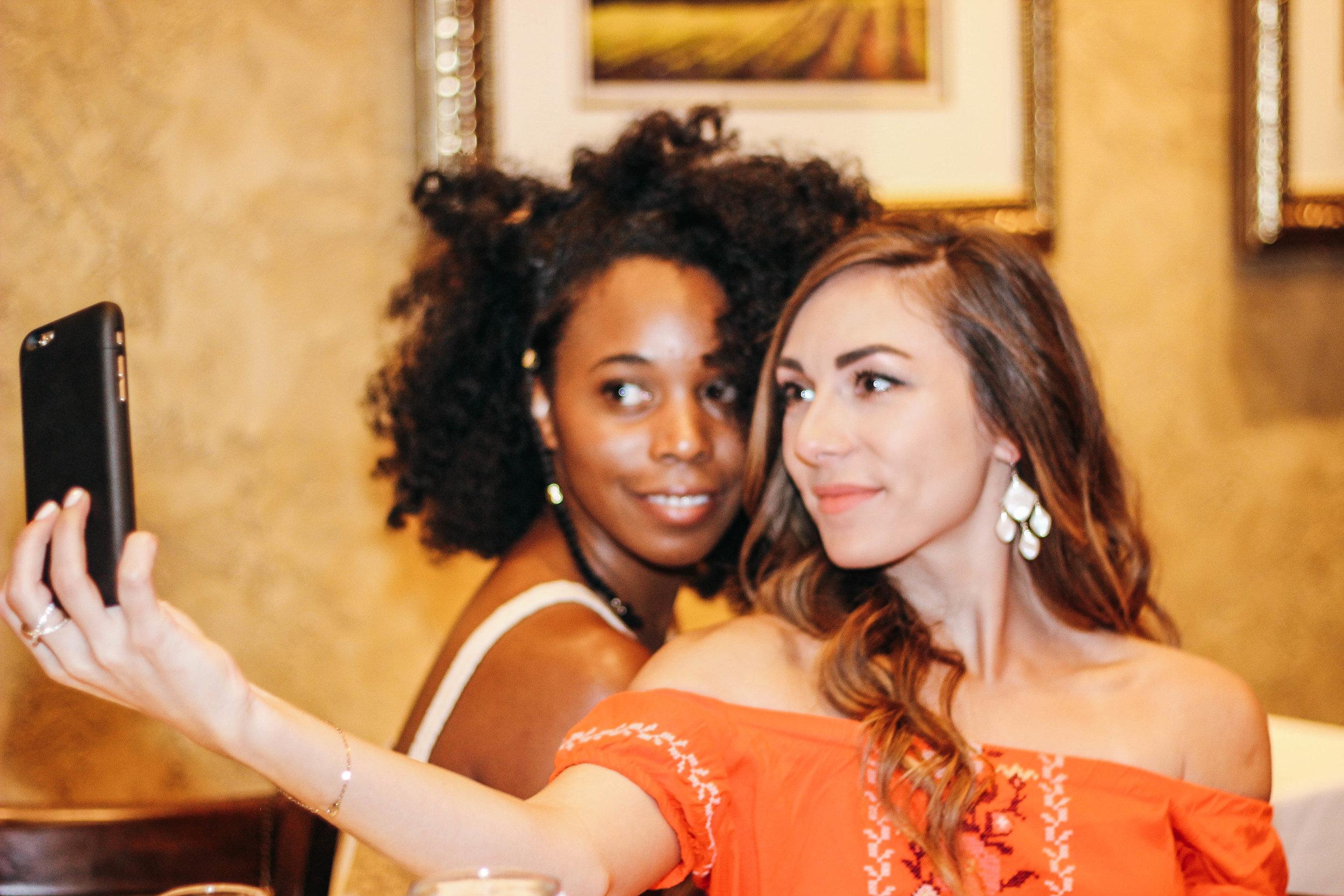 women taking pics at jasmine diane brunch.jpg
