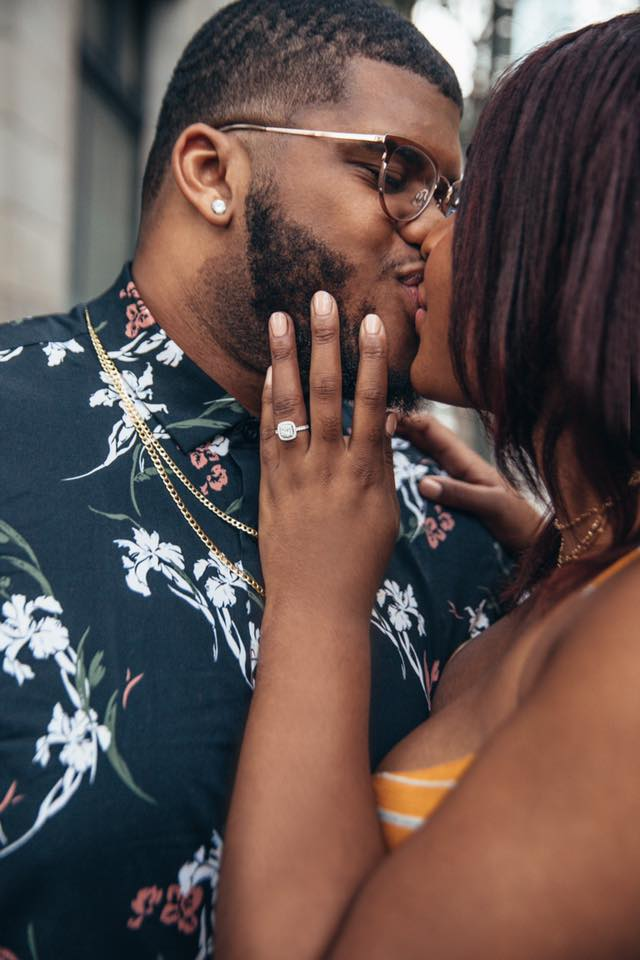 Black love, Jasmine Diane and Steven Green, kissing at engagement shoot in downtown LA.