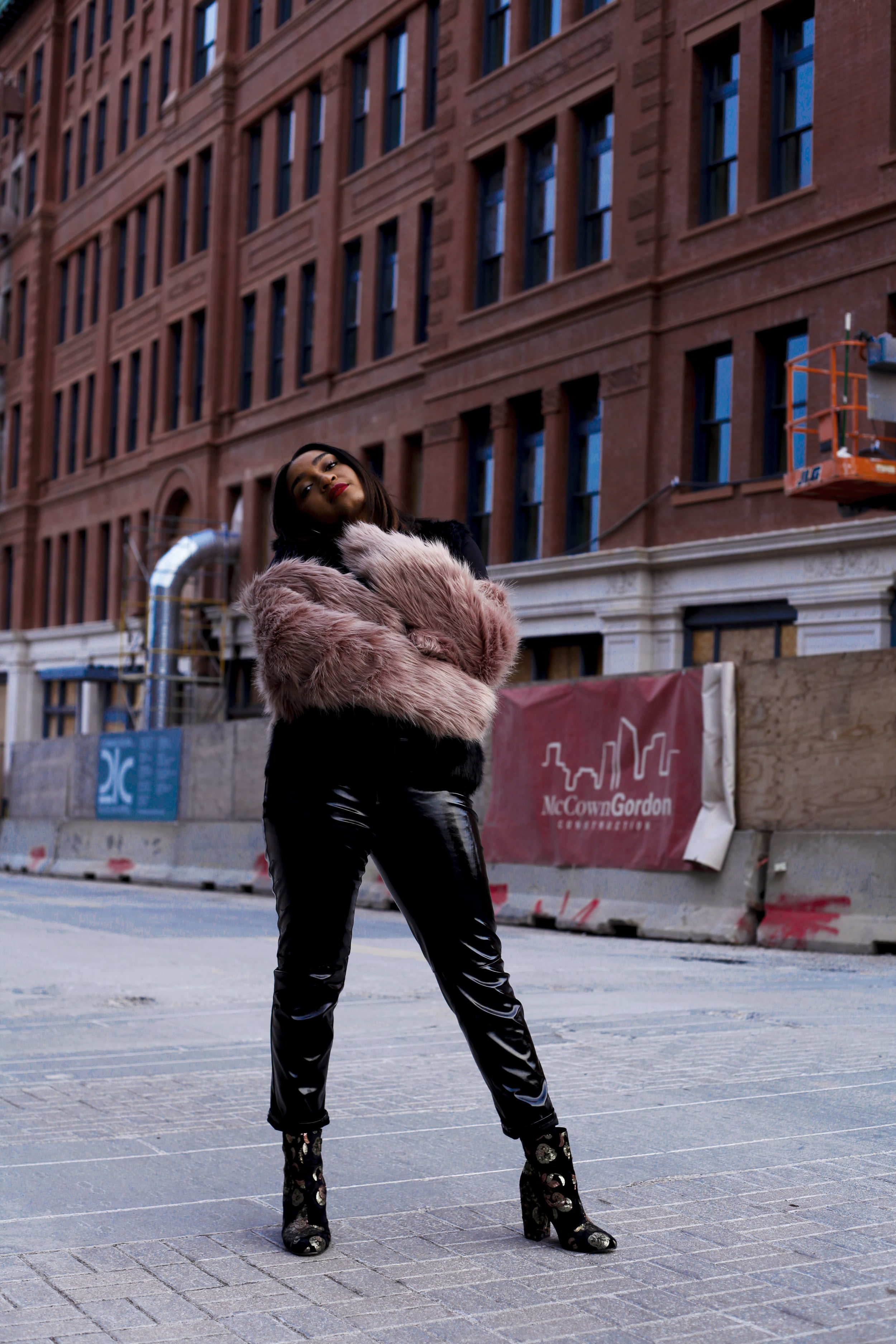 top kansas city fashion blogger, jasmine diane, wearing leather pants and purple coat.
