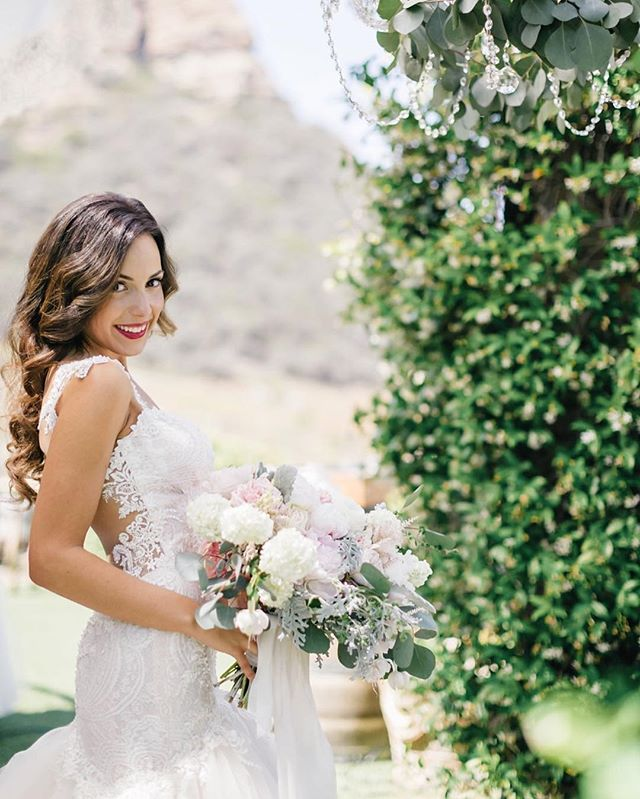 Happy brides are the prettiest brides. Photography: @janawilliamsphotos_  Beauty: @nicole_teamhairandmakeup (makeup) and @bailey_teamhairandmakeup (hair) using @thmhairextensions in color Felicia  Dress: @galialahav  Venue: @saddlerockranch_events