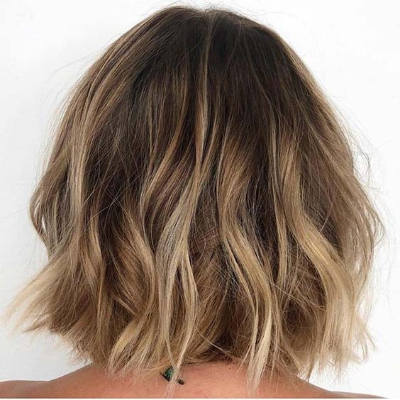Dirty Blonde Bob - This bob couldn't look more beachy if it tried. Blended warm blondes are mixed throughout to create the overall look that will only get more glowing with every step in the sun.