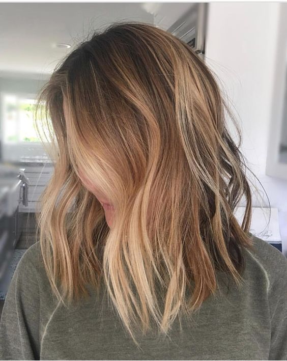 Face Frame Honey Highlights - Keep your roots—and most of your hair—its natural brown for the most minimal upkeep, and add in major face framing with blonde in a matching tone. In this case, a warm honey blonde complements a warm medium brown.