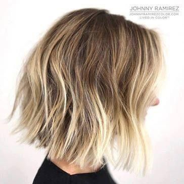 Lived-In Blunt Bob - This warm platinum short cut has blonde roots and a perfectly sandy middle section that makes the blonde ends look perfectly blended. The super light blonde works well on the blunt bob.