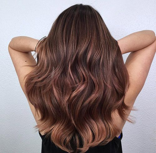 Rose Brown Balayage - The hottest new hair color for brunettes this year is unarguably stunning rose brown balayage. It takes the rose gold trend and turns it into a rich, warmer shade that makes brown hair look almost metallic.