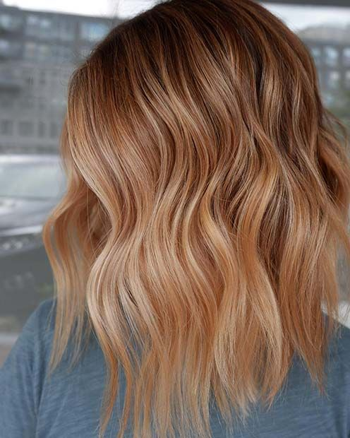 Strawberry Blonde - This blonde-brown shade favors the popular rose brown trend but takes it a little lighter and adds a strawberry tint that's simply perfect for sunny days this summer. The strawberry blonde ends look perfectly blended into the warmer base.