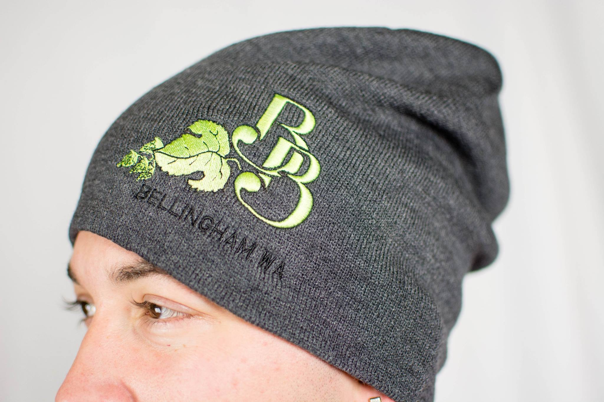 "Slouch Beanies   Fitted caps and snapbacks in the summer, beanies for the winter. Here's a slouch beanie hand embroidered with Boundary's  BB  hop logo with ""Bellingham"" sewn underneath. Also comes in pink!"