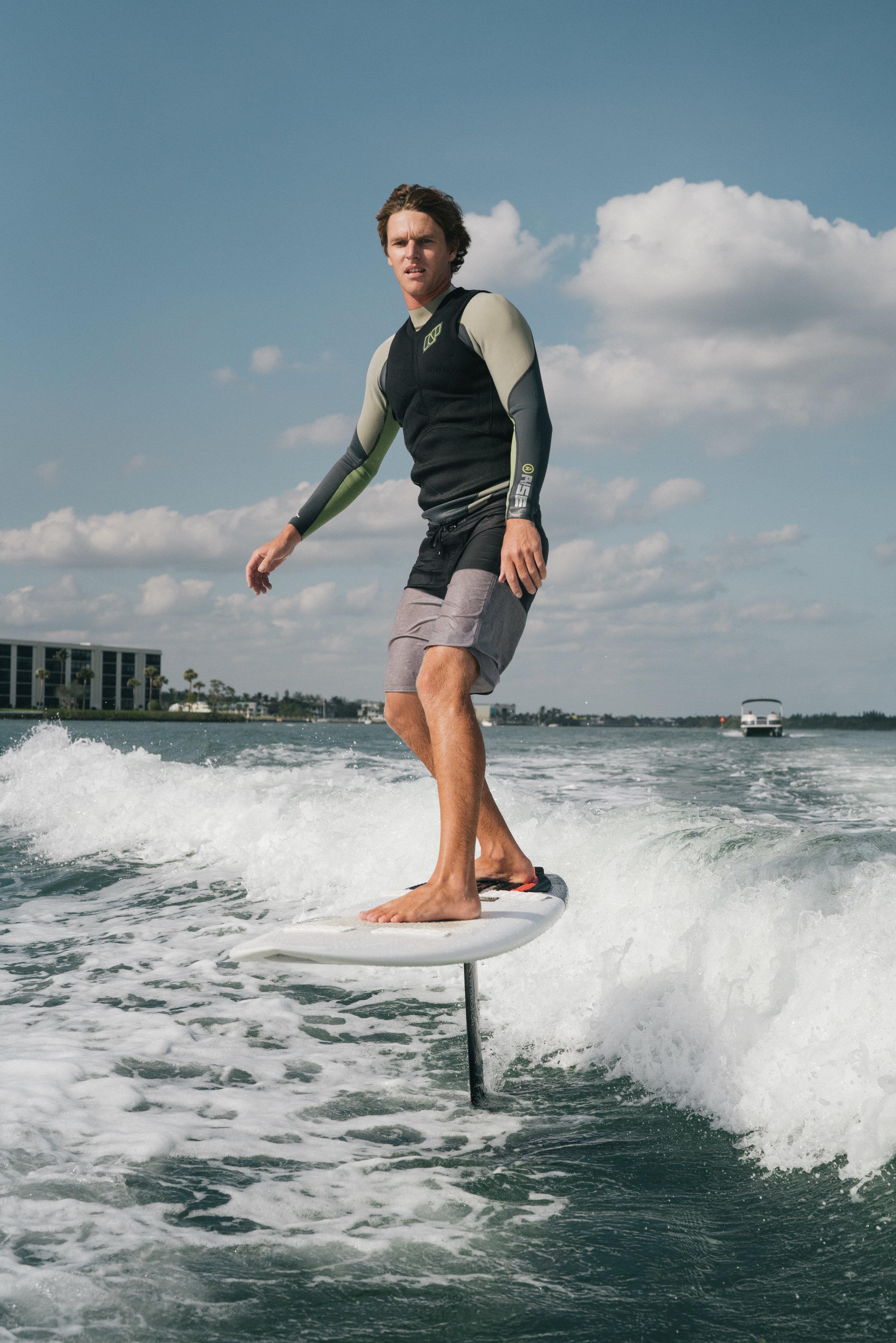 Wake foil surfing