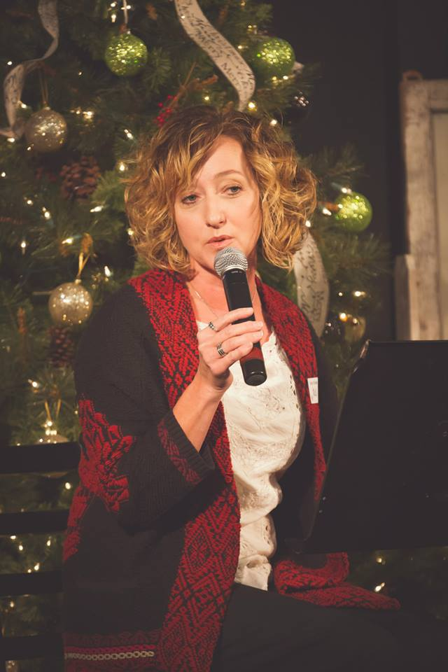 Kelli speaking Christmas.jpg