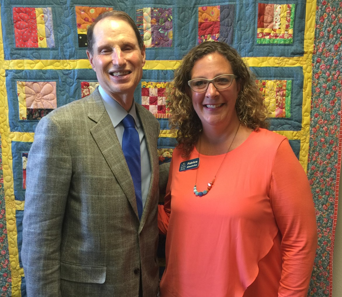 Sen. Wyden visits with staff at a HFA site in Salem, OR.