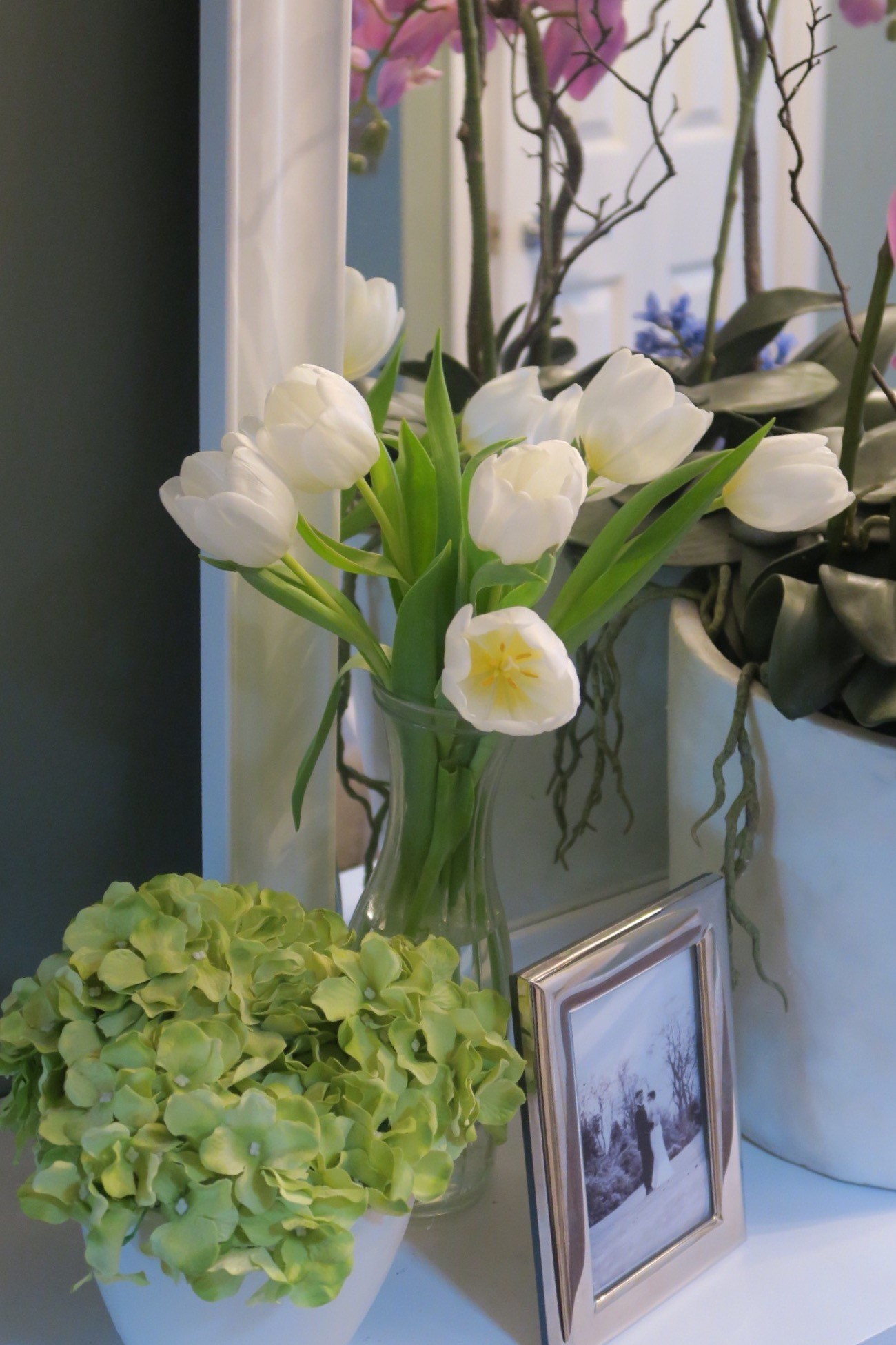 Mixing real flowers in with fakes keeps the display varied and visitors guessing.