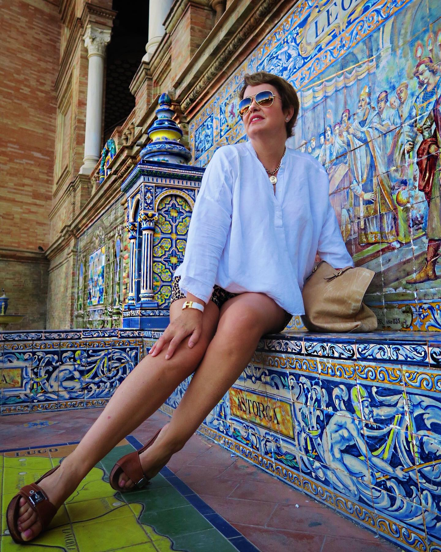 Sincerely Yours Susie sittingat Sevilla's Plaza de Espana. Photo credit Susie Cormack Bruce.jpg
