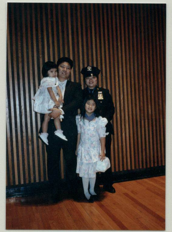 Chan, with husband Wilson and daughters Tiffany and Stephanie, at a promotion ceremony at 1 Police Plaza in 1991.  Credit: Agnes Chan