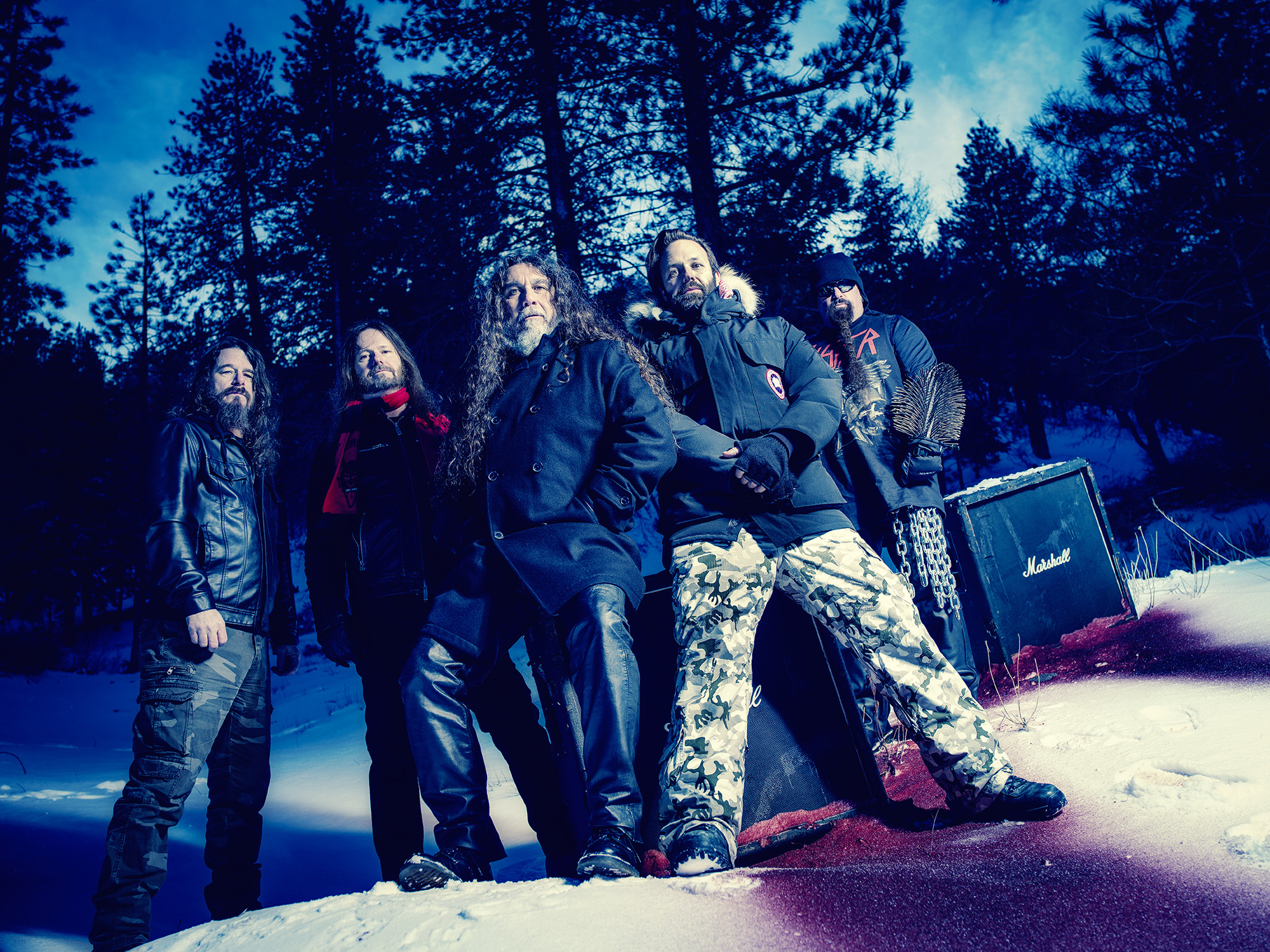 """SLAYER with director BJ McDonnell on the set of the """"Pride in Prejudice"""" video in the mountains of Wrightwood, CA, 2/2/16 L-R: Paul Bostaph, Gary Holt, Tom Araya, BJ McDonnell, Kerry King Photo credit: Martin Hauser"""