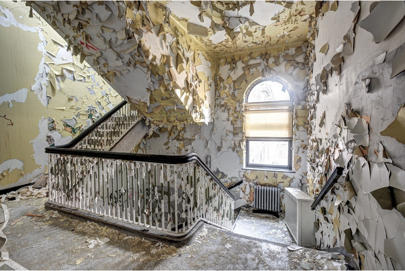 """Eric Holubow's """"Shedding Stairwell"""" shot in 2008 at the Hyde Park Hospital in Illinois."""