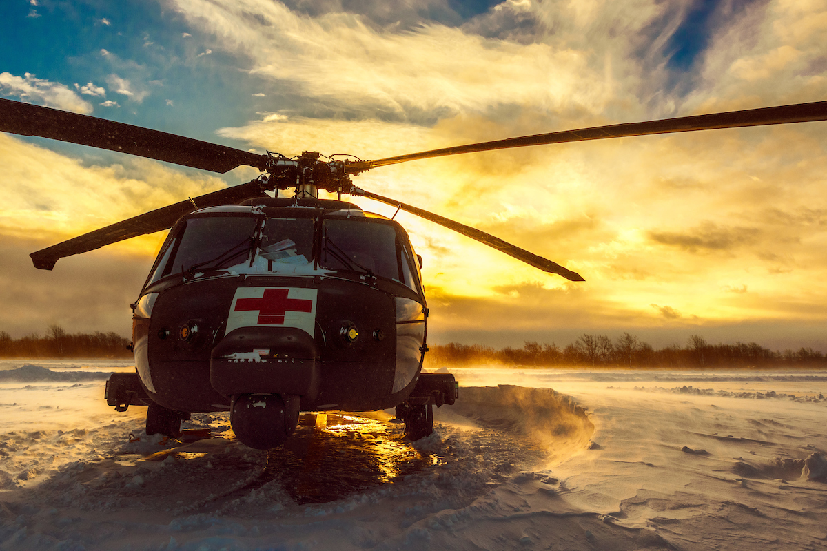 Icy Dawn  HH-60 MEDEVAC Blackhawk with C 3-10 GSAB sits ready to respond as the sun rises and during a Lake Effect Storm Warning