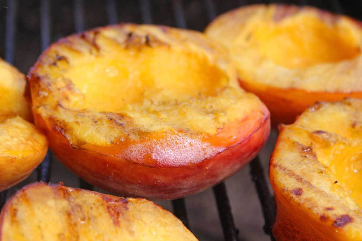 Grill the peaches with the oiled cut-side down