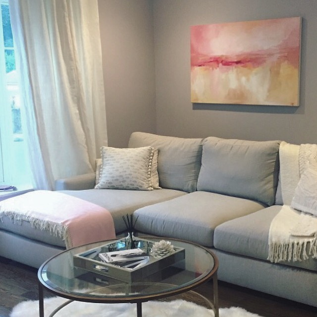 Art by Megan original painting hanging above a sectional couch.  Painting measures 30x40.