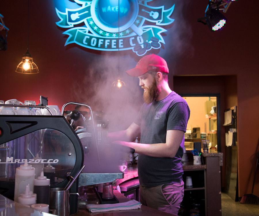 MASTER CRAFTSMAN:  Barista Jonathan Mizer makes a latte at Classic Rock Coffee.