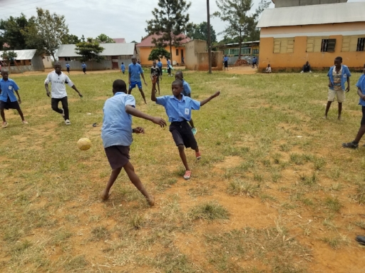 Our upper level boys practice soccer in the school's field