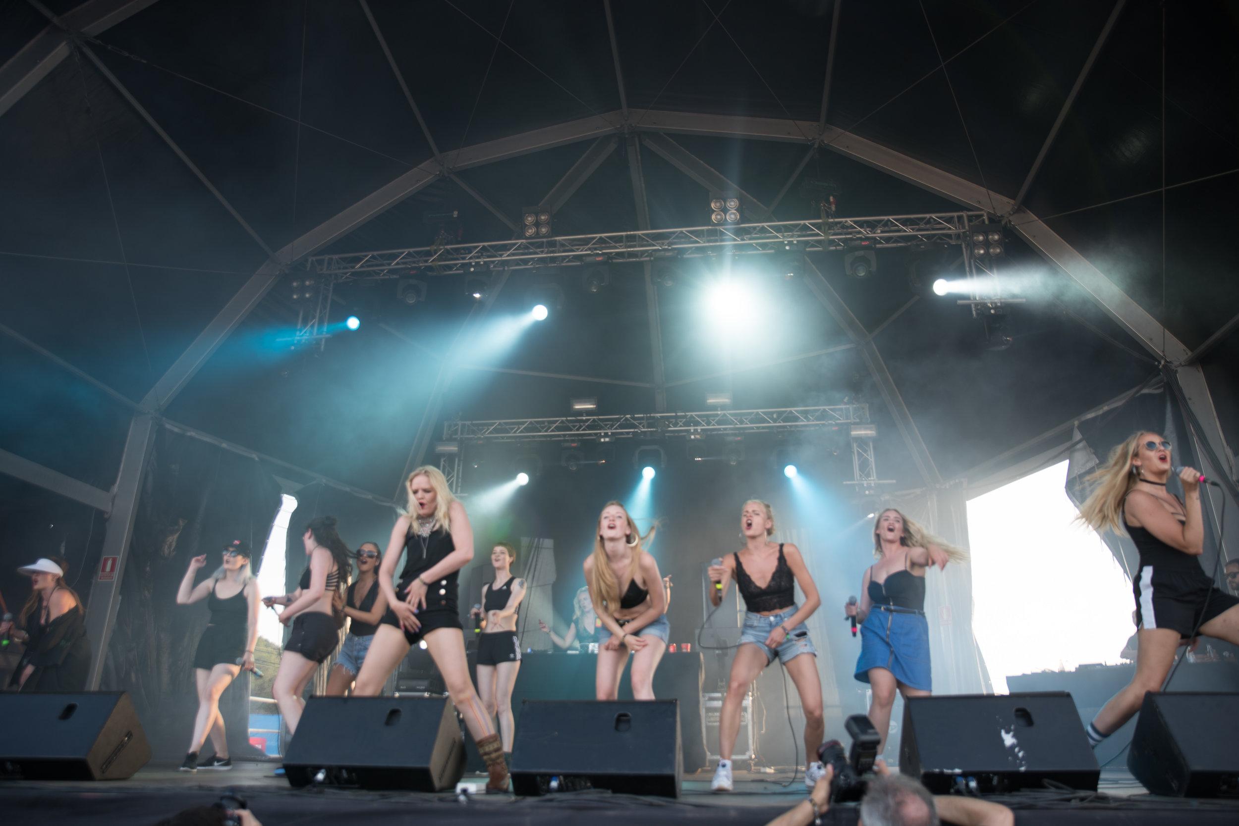 "The 16 piece feminist ""rap clan"" Reykjavíkurdætur performing at Benicàssim Festival in Spain last year. Credit: Iñaki Espejo-Saavedra (Flickr)."