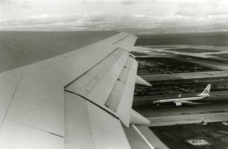 Plane Landing From Plane Taking Off