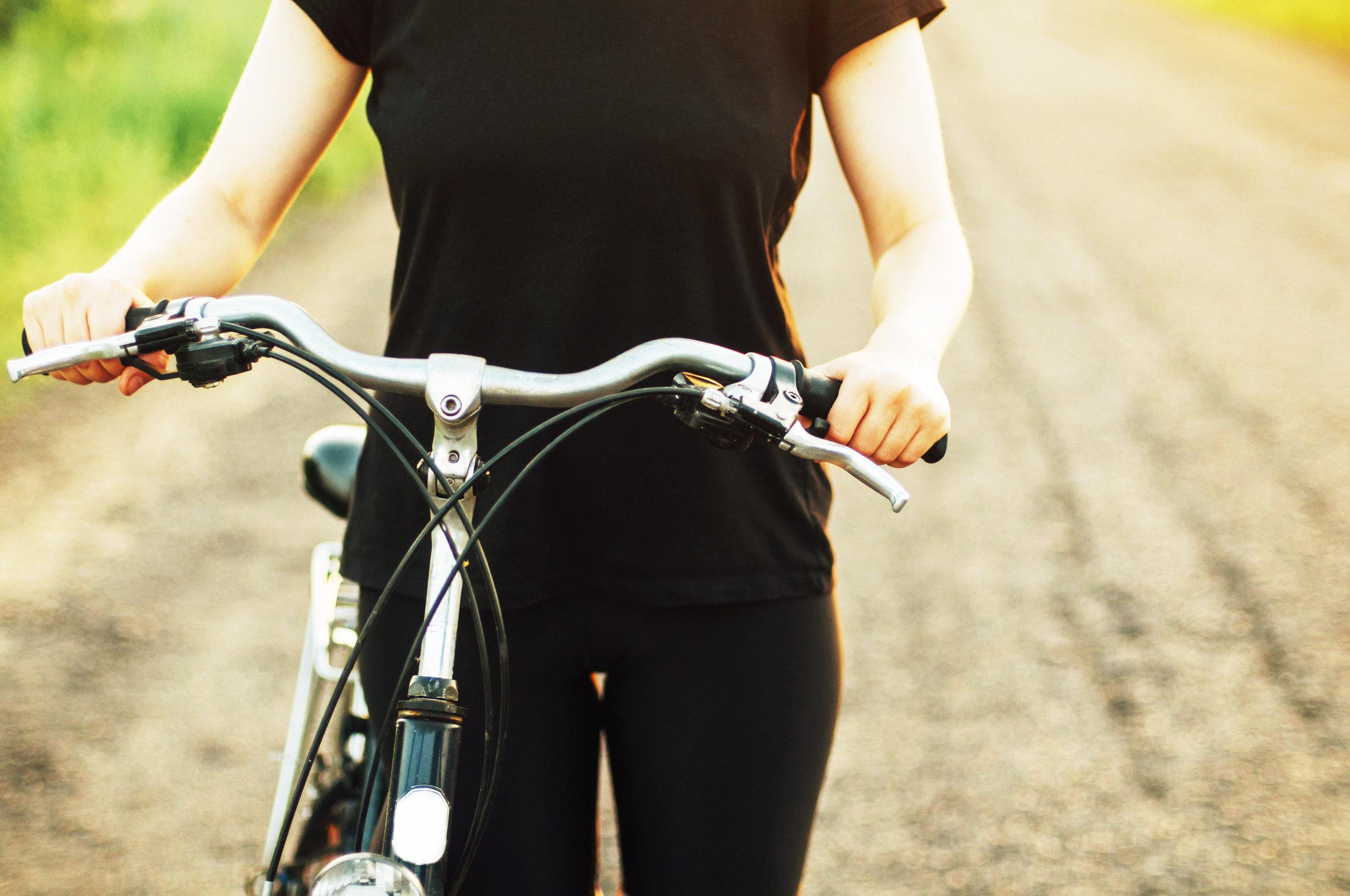 bigstock-Detail-Of-A-Bicycle-Woman-Rid-137602982.jpg