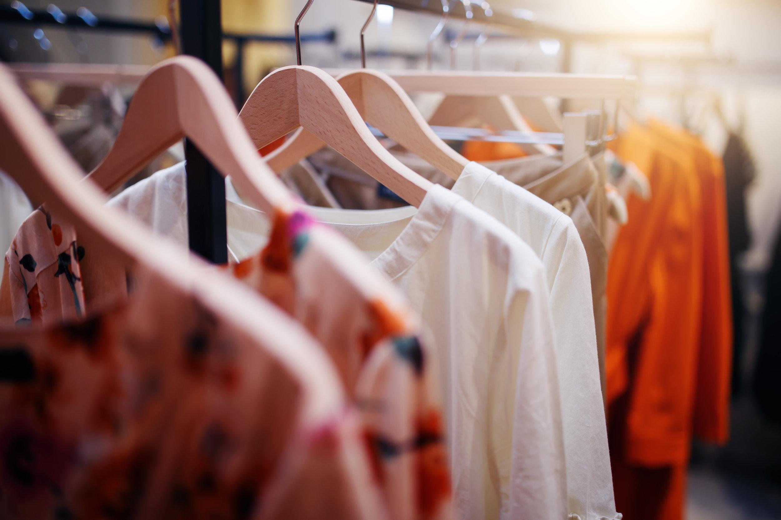bigstock-Clothing-On-Hanger-At-The-Mode-131136365.jpg