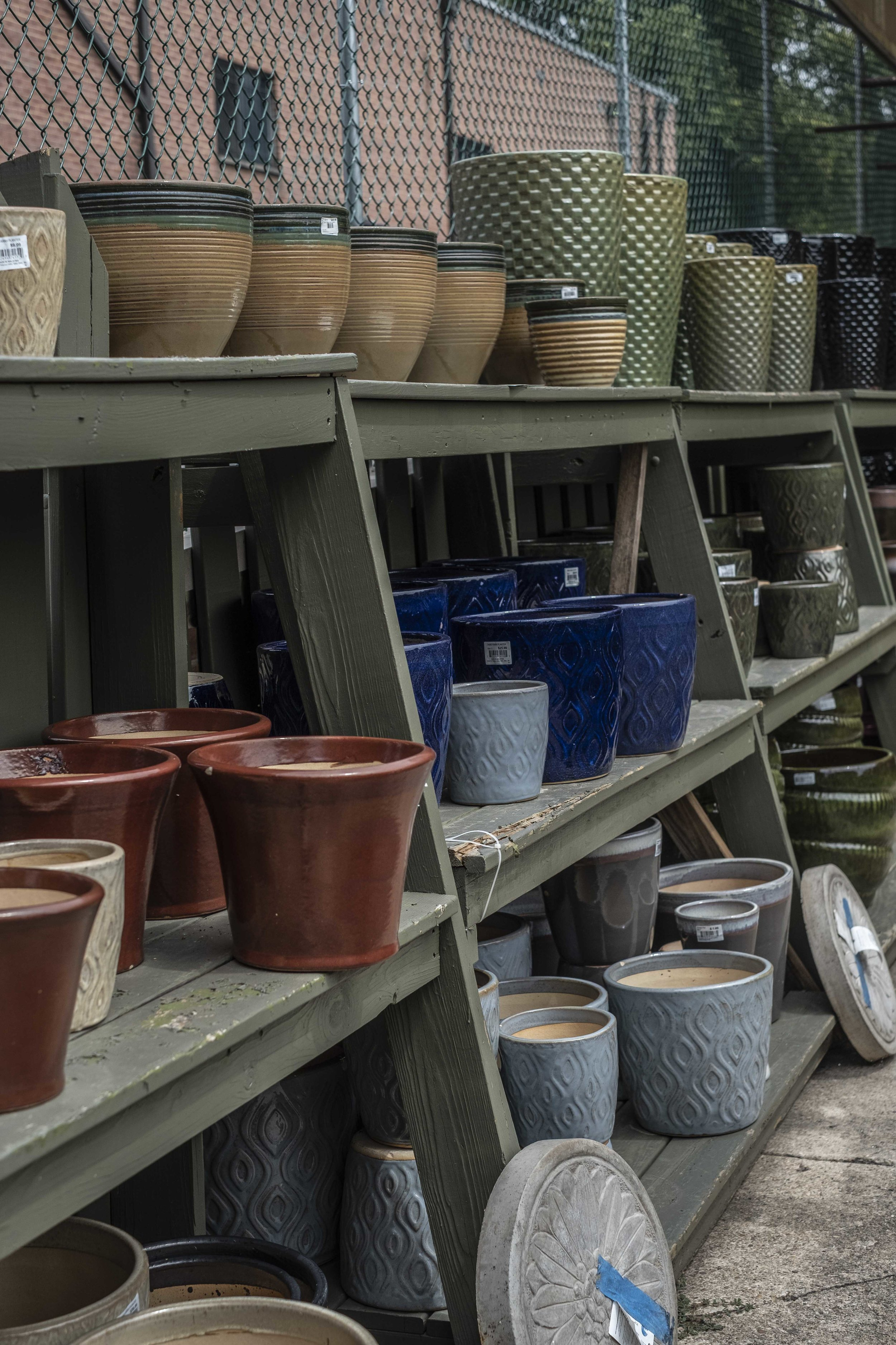 Finding quality, reasonably priced pottery can be really difficult. I'm guessing but they probably stock the nice ceramic glazed pots on a seasonal basis.