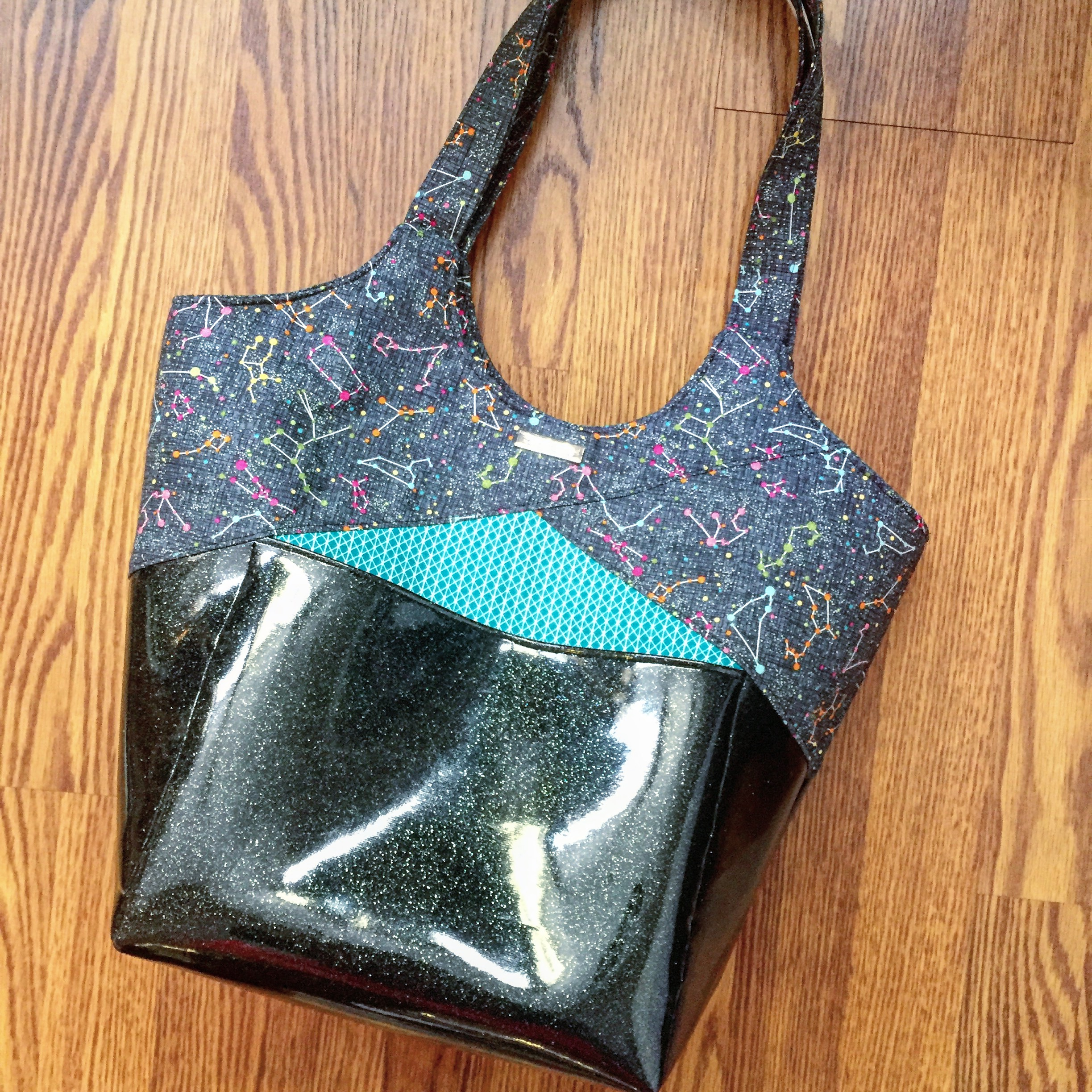 The Stand Up & Tote Notice pattern by Lisa Ratford of Two Pretty Poppets in sparkle vinyl. Constellation fabric by Timeless Treasures.