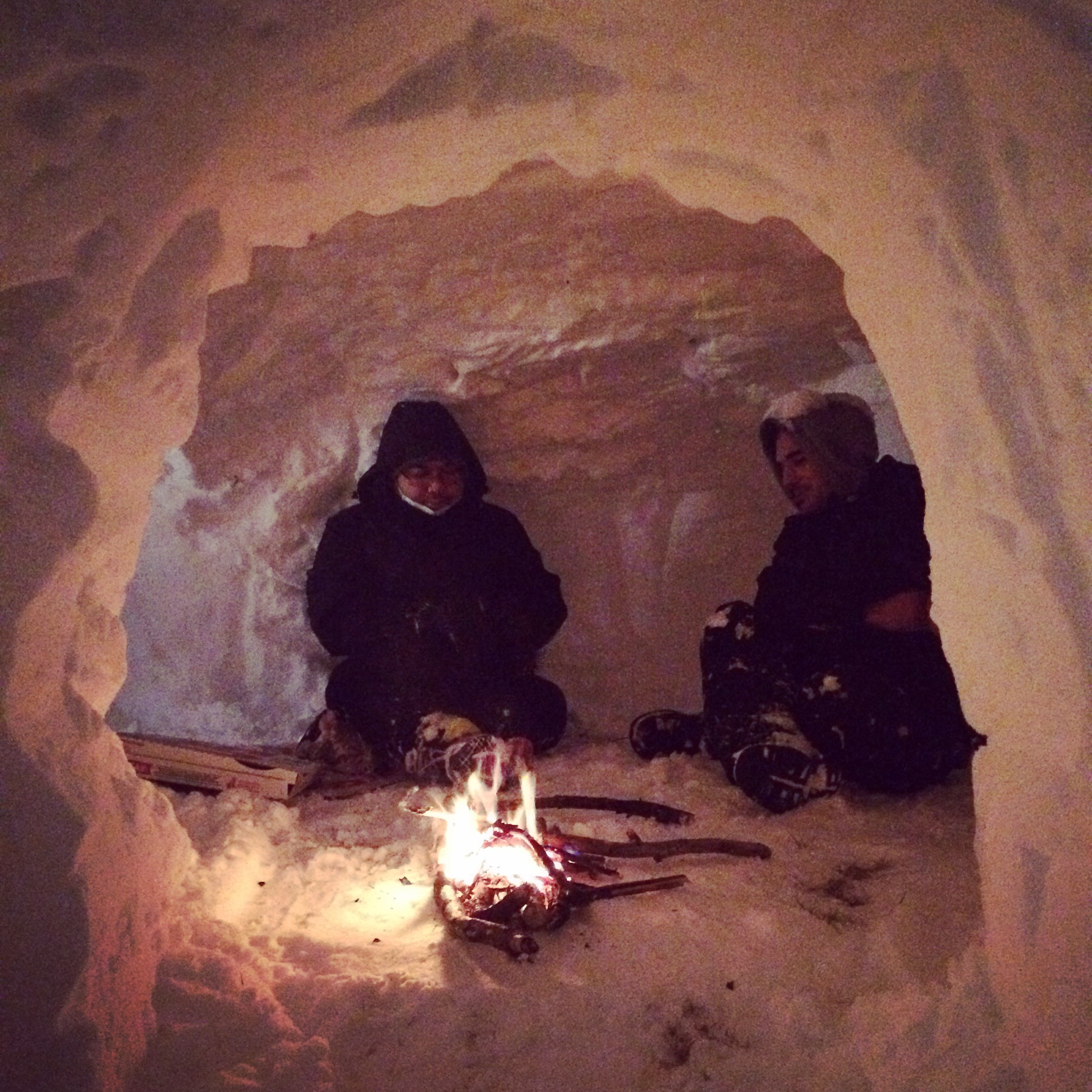 Jesse and my brother Jon, keeping warm inside of the igloo we built.