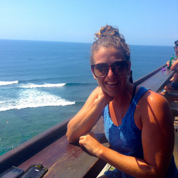 Sitting on the cliffside at Uluwatu, watching the surf... after my session of course. :)