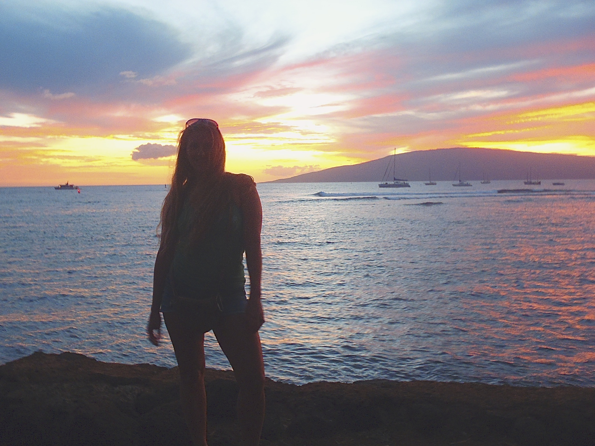 Me in Lahaina a few years ago... had to get a sunset photo. :)