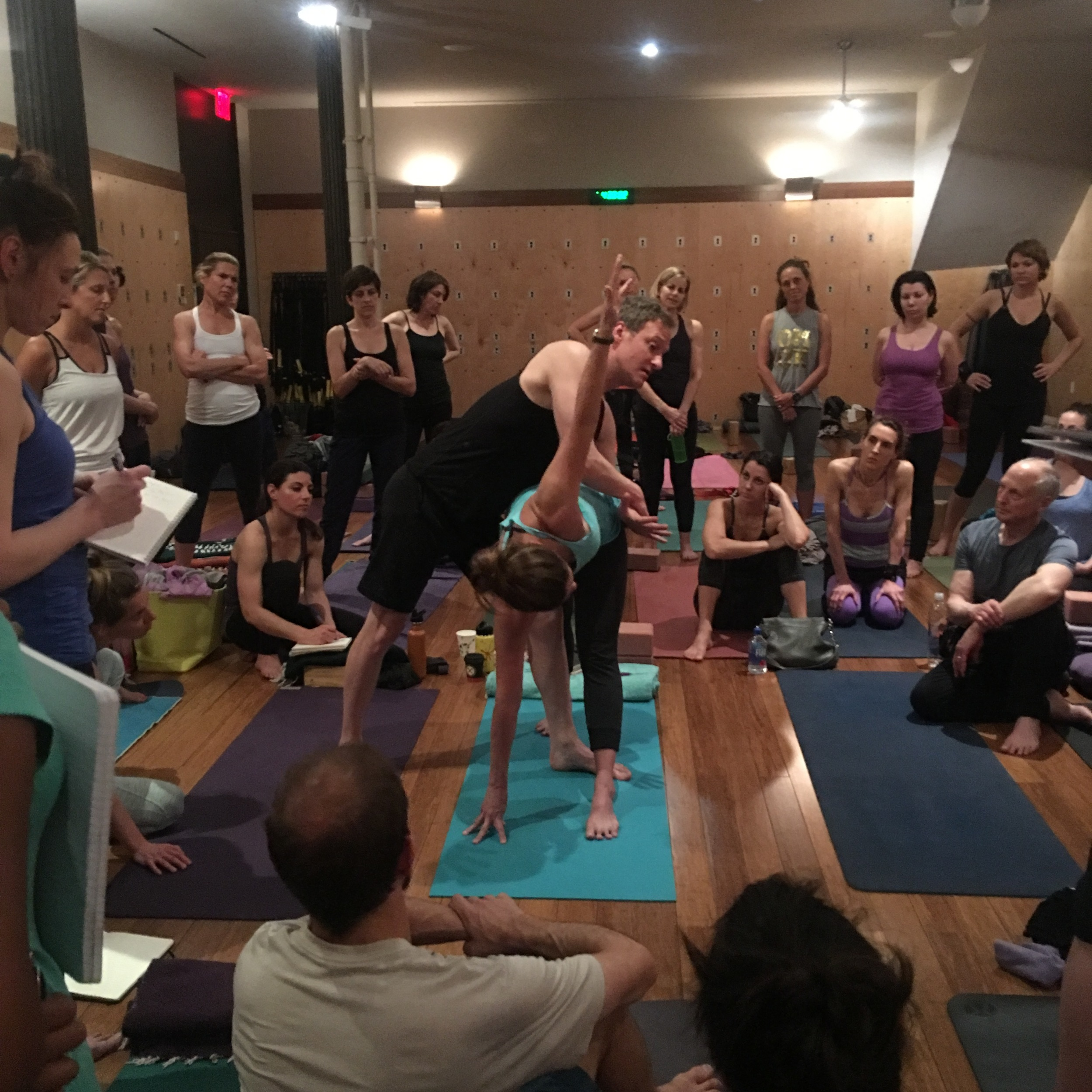 Jason Crandell  demonstrating an adjustment on revolve triangle pose, during his 3 day retreat in NYC.