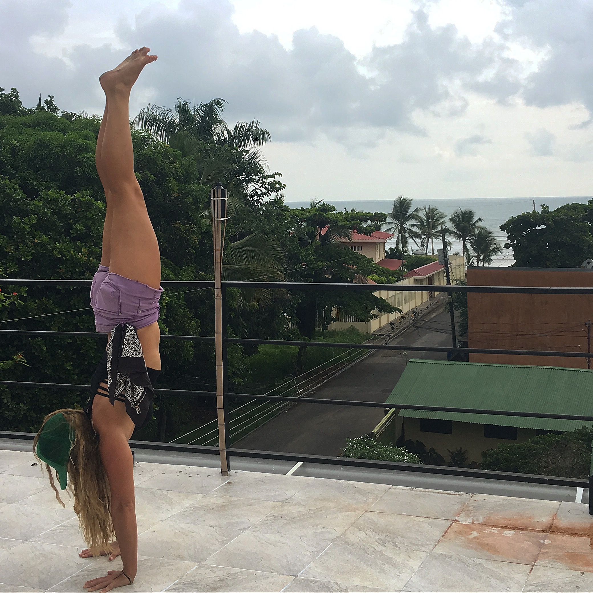 Handstanding on amiga's rooftop in Jaco, Costa Rica.