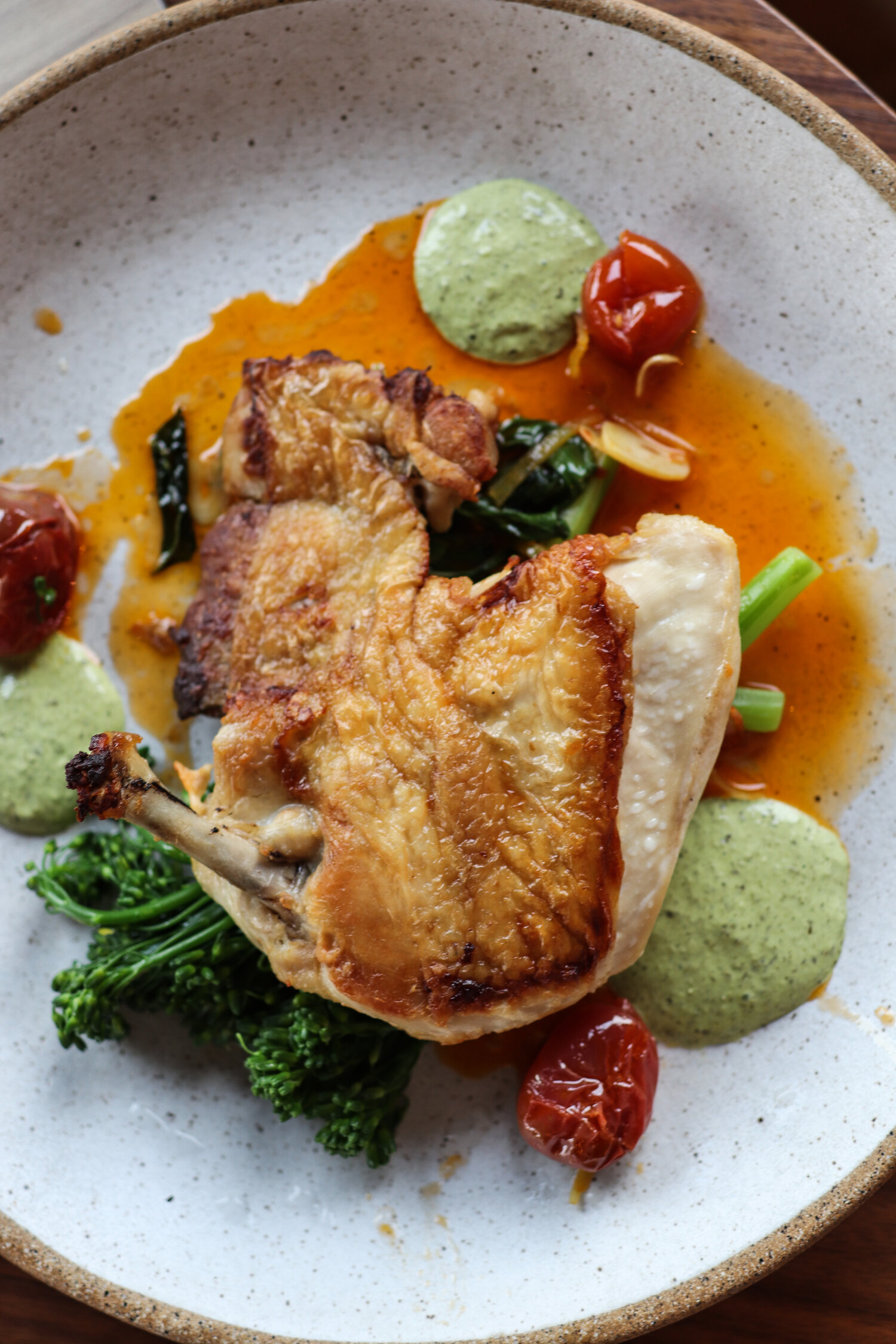 Brick chicken finished in the Marra Forni with blistered tomatoes, broccolini, and creamy salsa verde that played like fresh green goddess dressing.