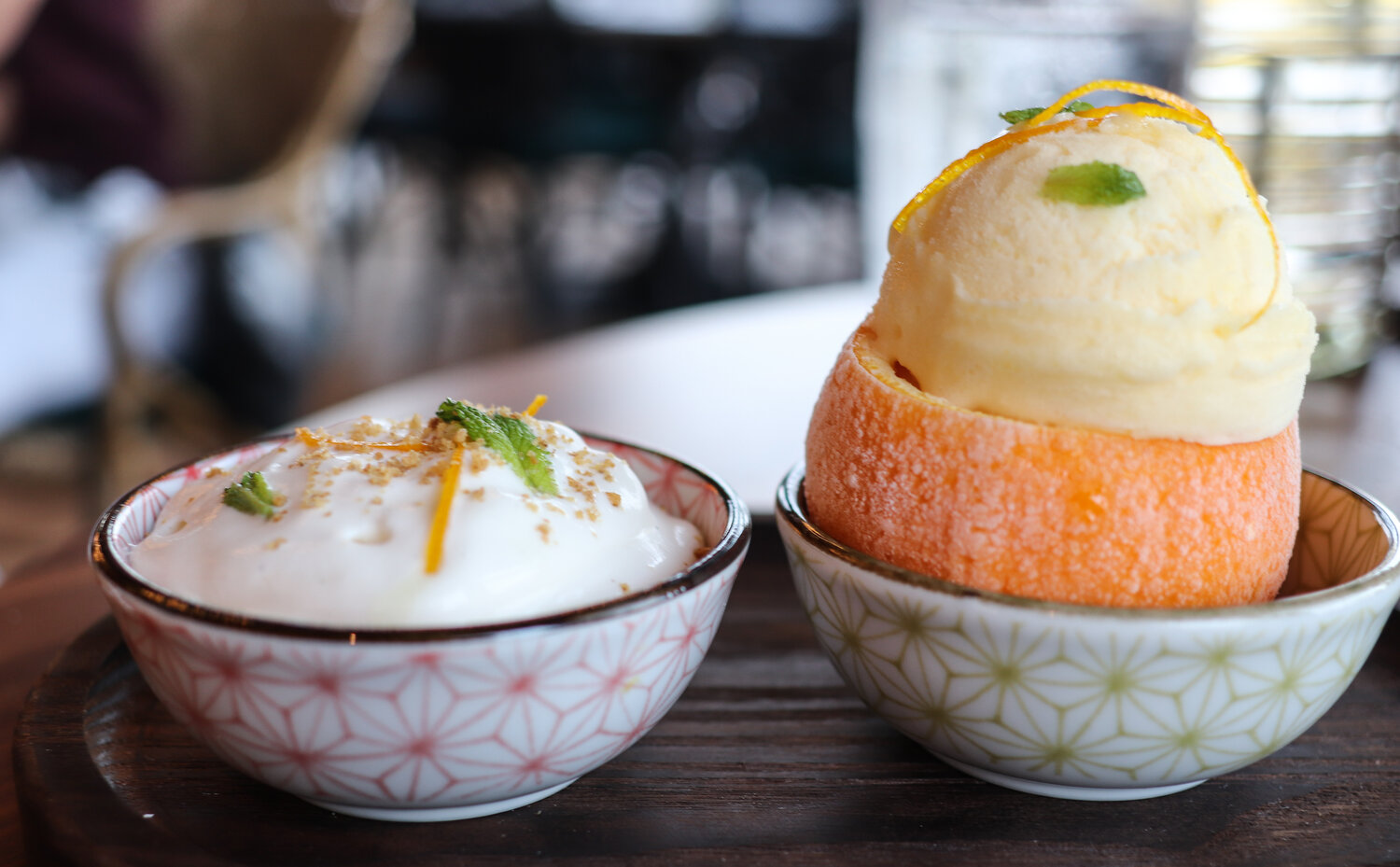 Lighter sweets include panna cotta and this…refreshing orange sorbet with candied orange peel, micro mint, and vanilla cream. Mix, match, have fun. It's a creamsicle reimagined.
