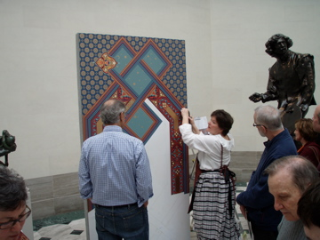 Heidi demonstrating the application of Bradbury wallpaper for the Legion of Honor presentation.