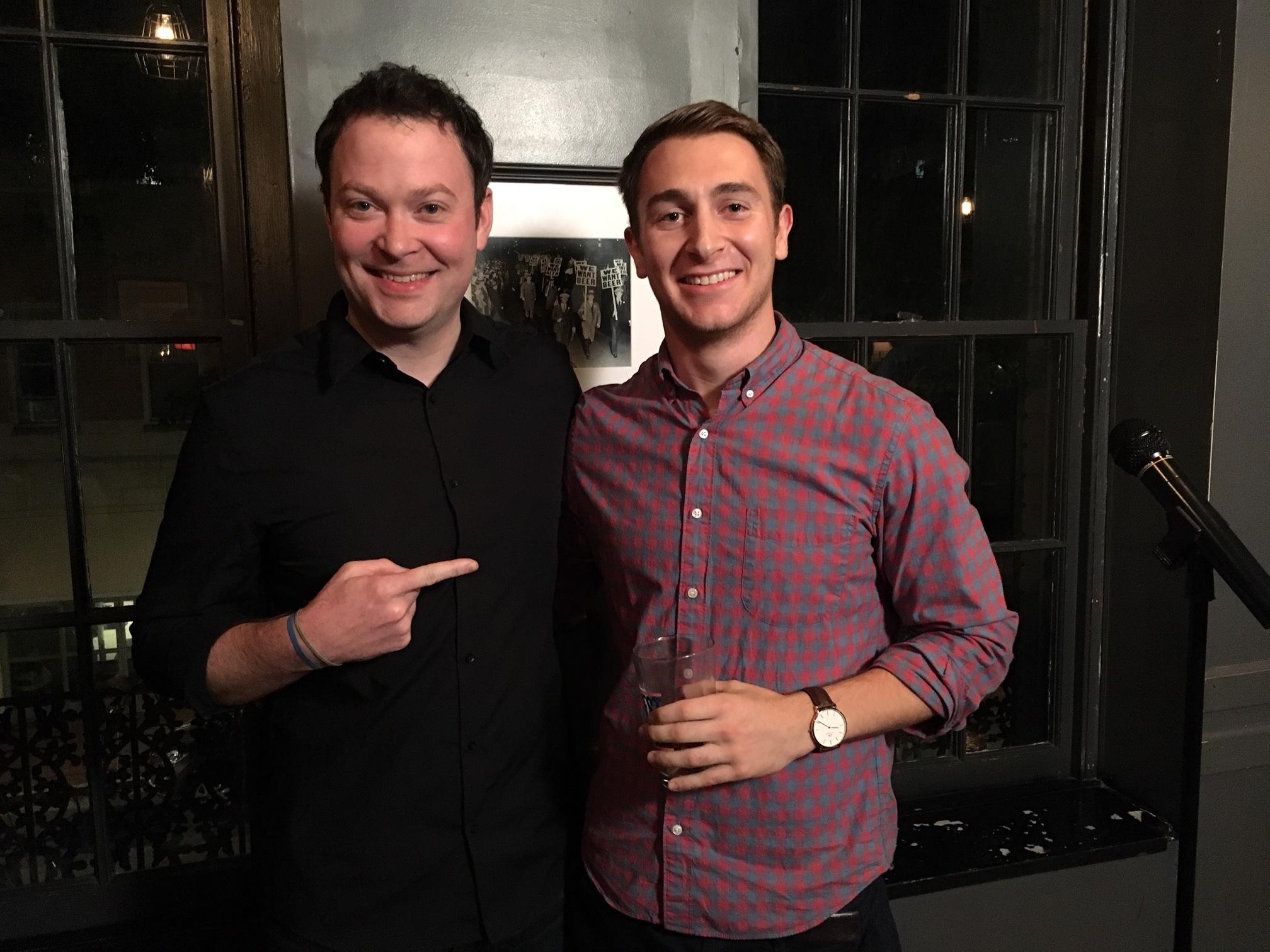 Emcee Mikey Gleason with winning storyteller Ethan Frankel
