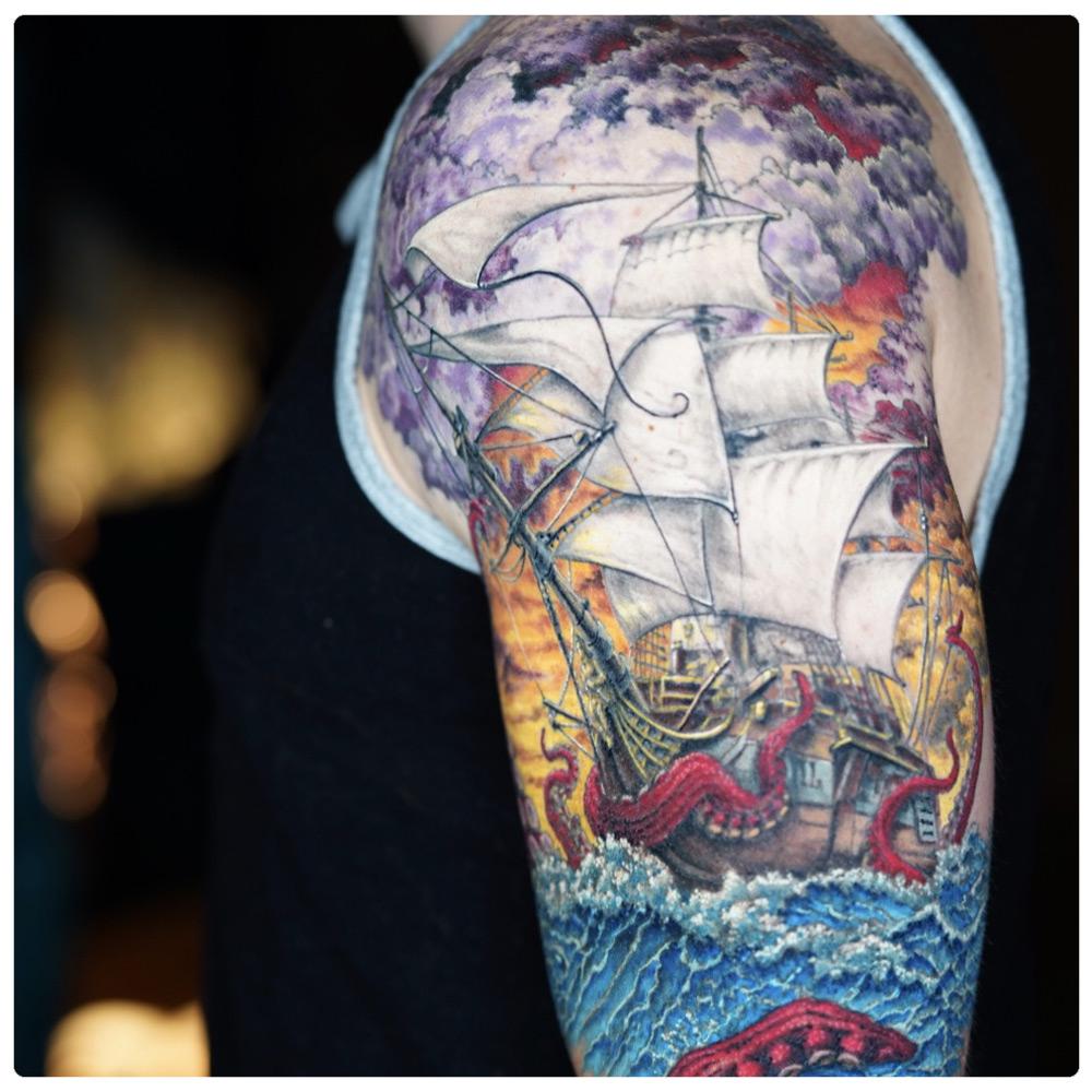 ig_2019_tattoo_arm-ship-sunset-octopus.jpg