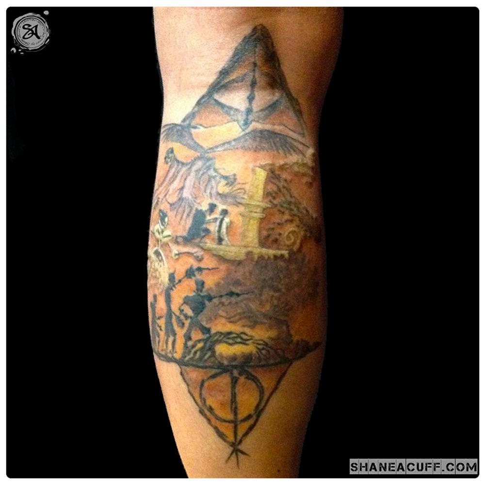 2014_tattoo_leg_deathly-hallows-scene.jpg
