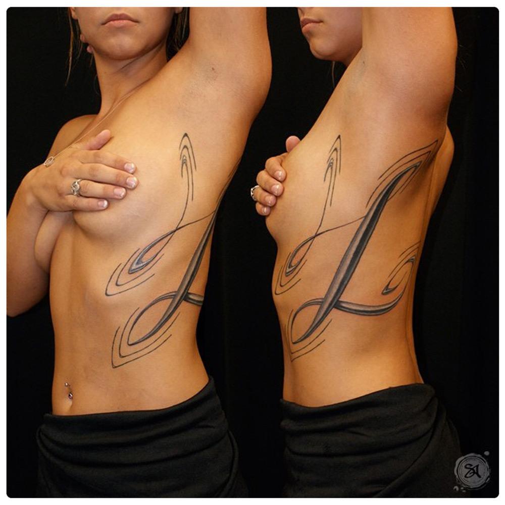 2011_tattoo_torso_script-letter-l.jpg