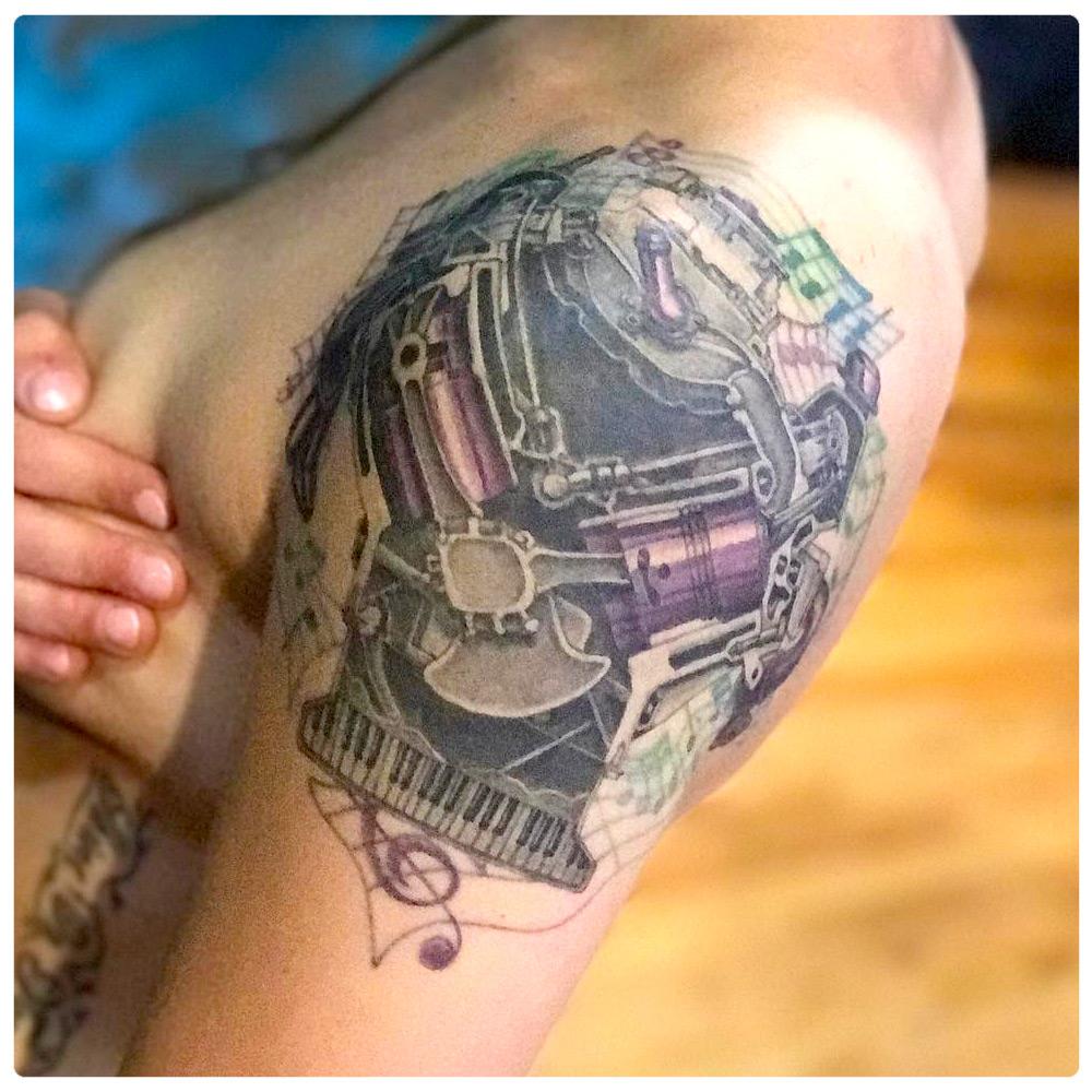 2017_tattoo_shoulder_piano-mechanical-music-notes.jpg