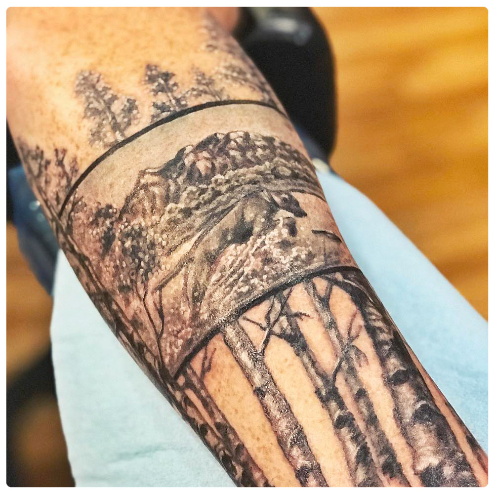 2017_tattoo_forearm_trees-nature-scene.jpg